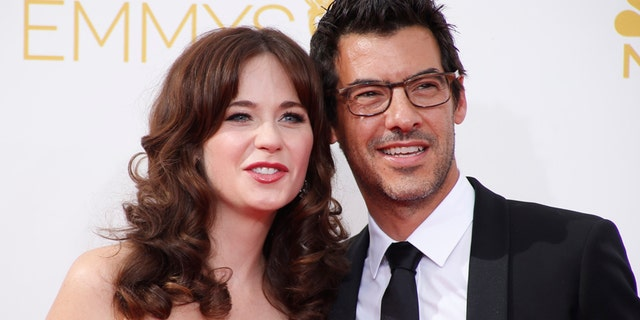 """Actress Zooey Deschanel, from the Fox sitcom """"New Girl,"""" arrives with Jacob Pechenik at the 66th Primetime Emmy Awards in Los Angeles, California August 25, 2014."""