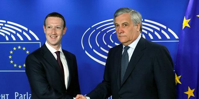 Facebook's CEO Mark Zuckerberg shakes hands with European Parliament President Antonio Tajani at the European Parliament in Brussels, Belgium May 22, 2018.