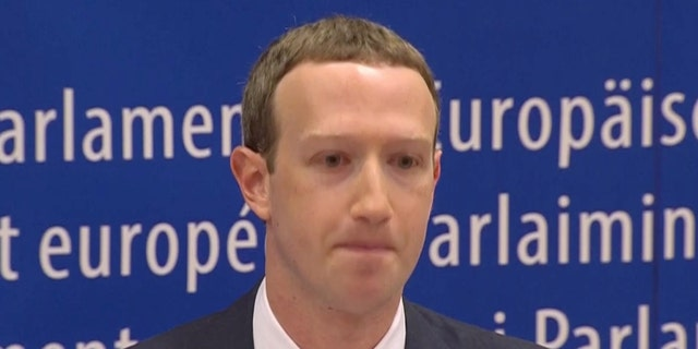 Facebook's CEO Mark Zuckerberg answers questions about the improper use of millions of users' data by a political consultancy, at the European Parliament in Brussels, Belgium.