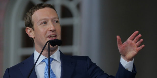 Facebook CEO Mark Zuckerberg, seen here at Harvard's commencement in May, has had to defend his company's response to Russian meddling in the U.S. 2016 presidential election.
