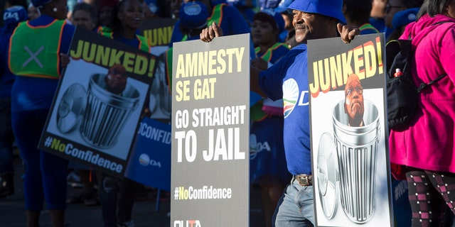 Protesters against President Jacob Zuma, march to parliament in Cape Town South Africa, Tuesday Aug. 8, 2017.