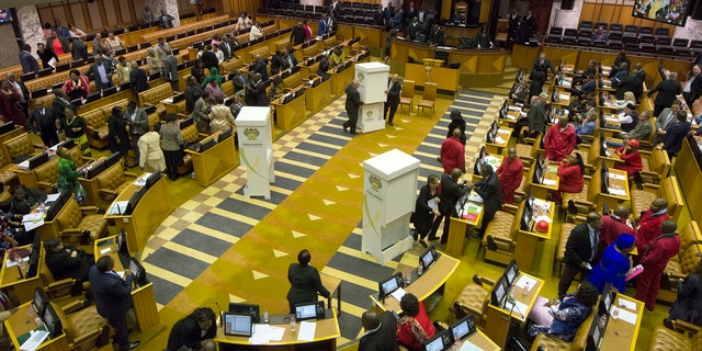Members of parliament prepare to vote for or against the motion of no confidence against South African president, Jacob Zuma in the South African parliament in Cape Town, South Africa, Tuesday, Aug. 8, 2017.