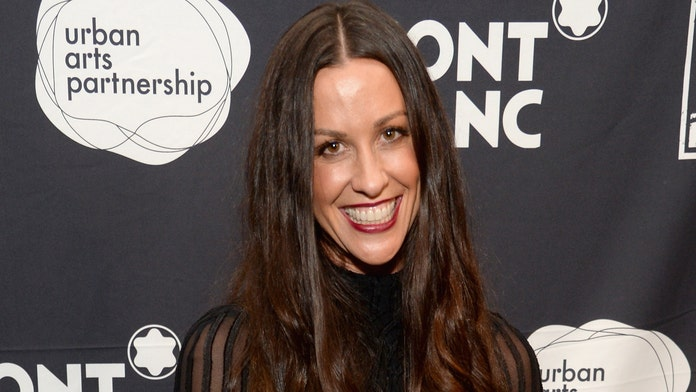 Alanis Morissette posts photo of her newborn son breastfeeding, says it's 'not always easy peasy'