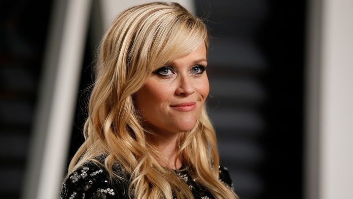 Reese Witherspoon, 43, says she's 'earned her gray hair and fine lines'