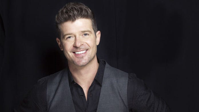 Woman who Robin Thicke groped in viral photo speaks out for 10 Year Challenge