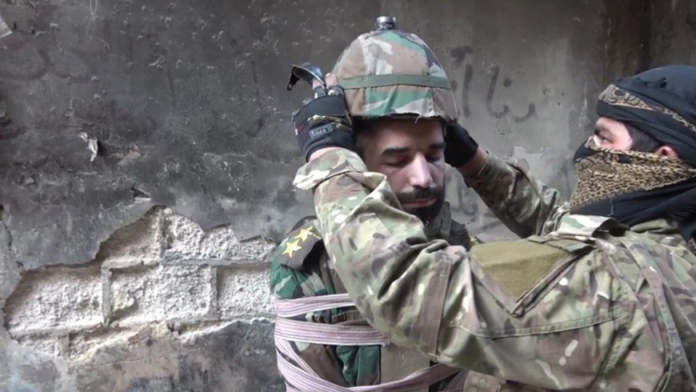 ISIS fanatics turn captured Syrian soldier into missile, attach bomb to his head before tossing him