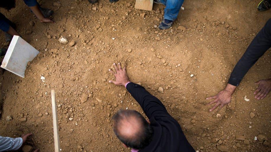 bf942148-Mideast Israel Palestinians