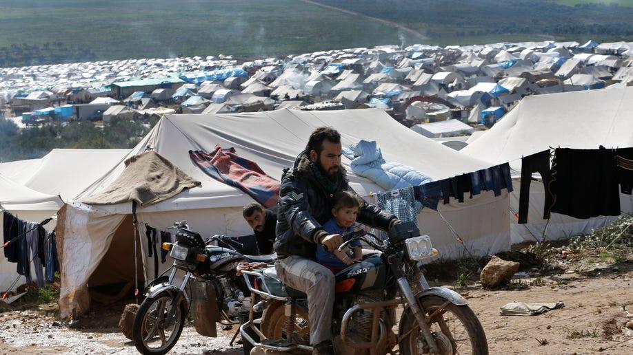 e620c824-Mideast Syria Displaced