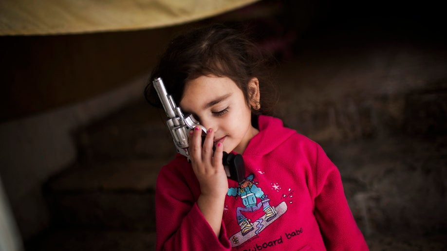 2156fa03-APTOPIX Mideast Syrian Refugees City Life