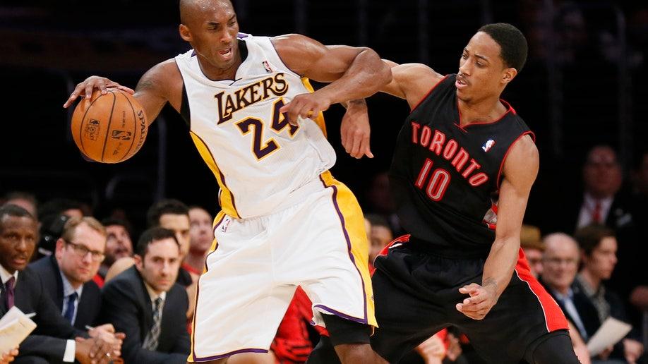 684c7cb9-Raptors Lakers Basketball