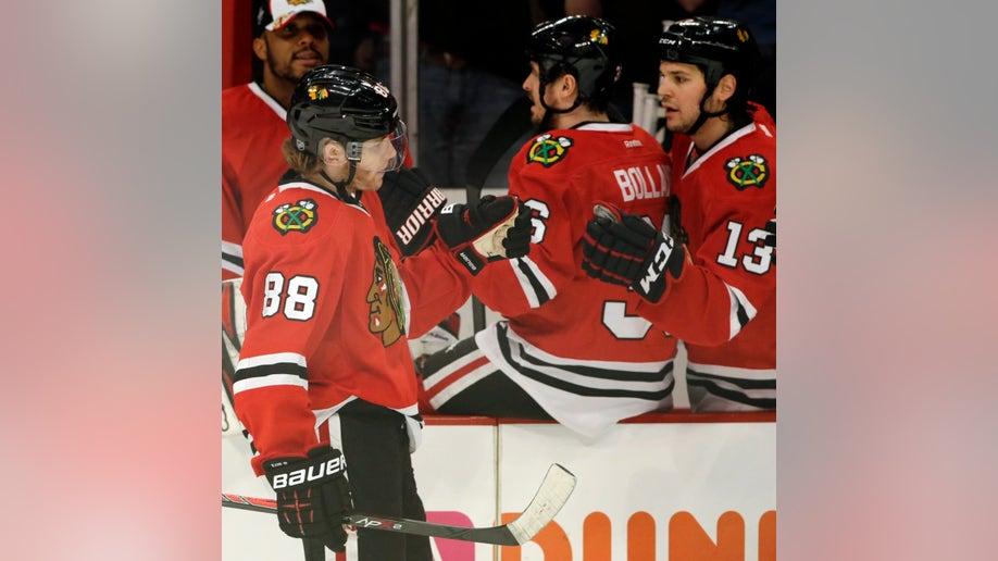 3b4ea89c-Red Wings Blackhawks Hockey