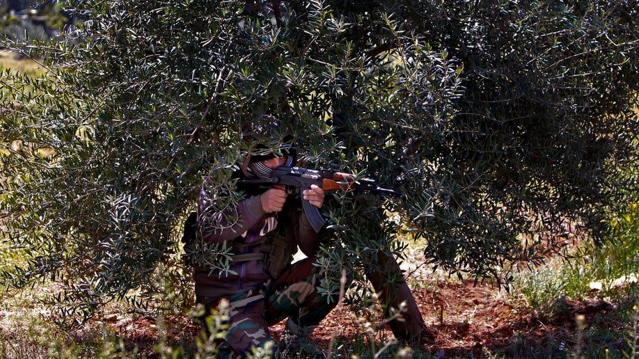 APTOPIX Mideast Lebanon Syria Shiite Fighters