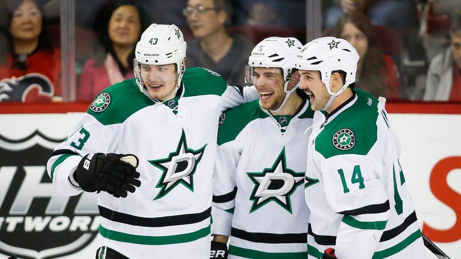 a91361ce-Stars Flames Hockey