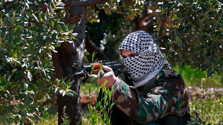 9025279c-Mideast Syria Lebanon Shiite Fighters