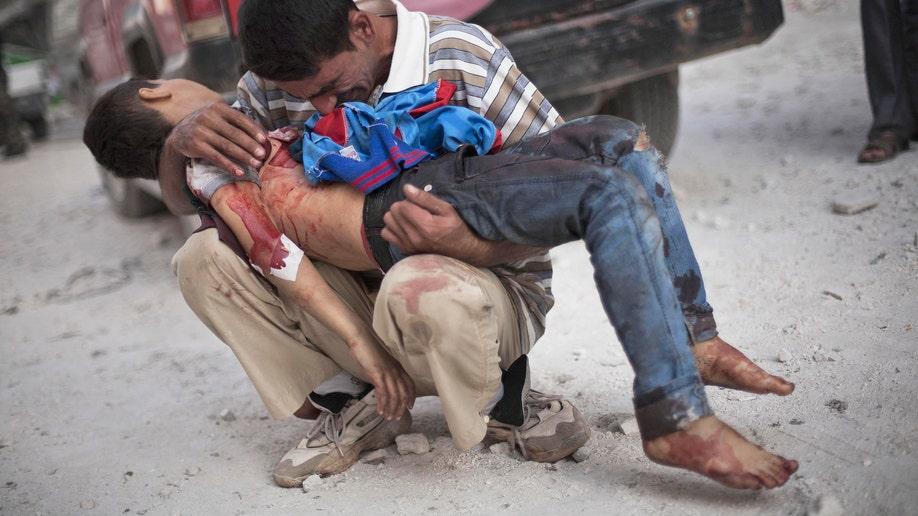 35013418-Mideast Syria Brutal War