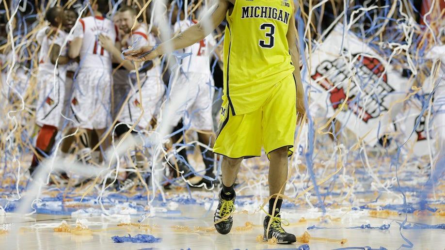 0ea3707f-APTOPIX NCAA Final Four Michigan Louisville Basketball