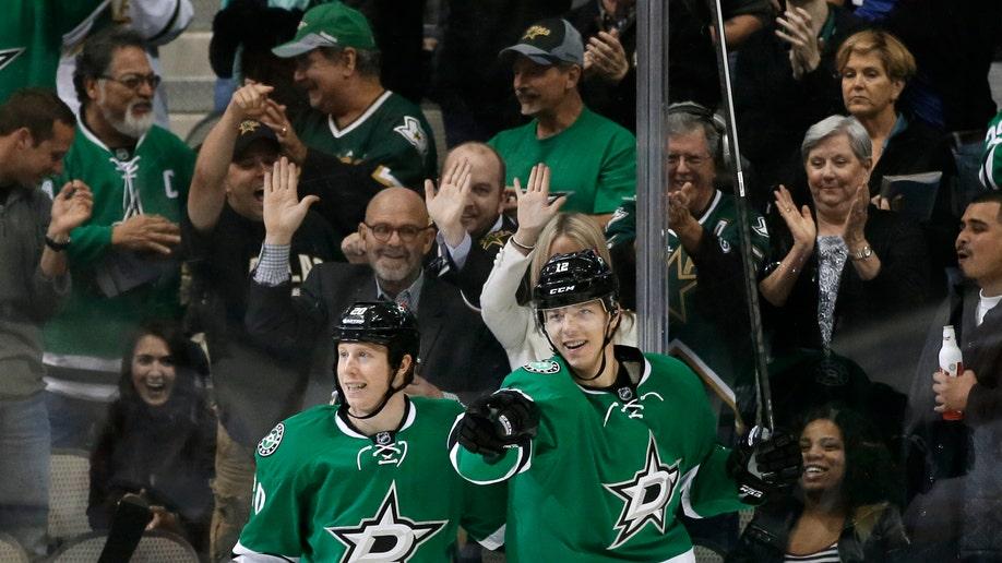 81245fe2-Flames Stars Hockey