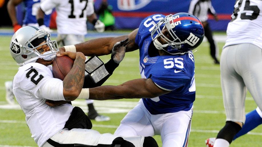 afdf2533-Raiders Giants Football