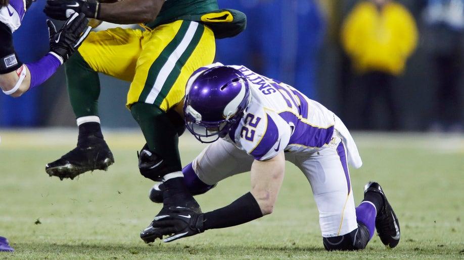 cd323cc8-Vikings Packers Football