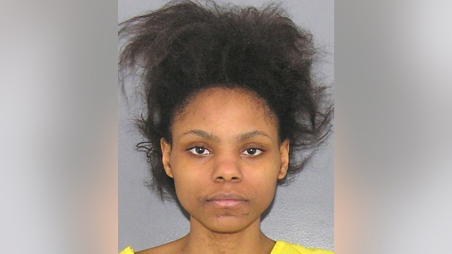 11bfbd30-Infant Decapitated Mother Charged