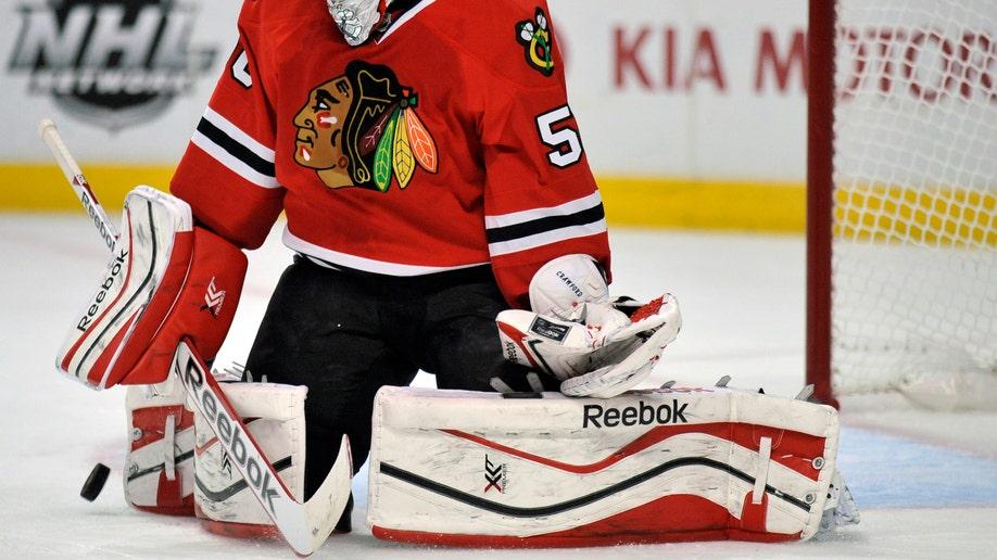 56996bc4-Sharks Blackhawks Hockey