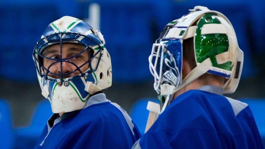 28bae9f2-NHL Labor Canucks Hockey