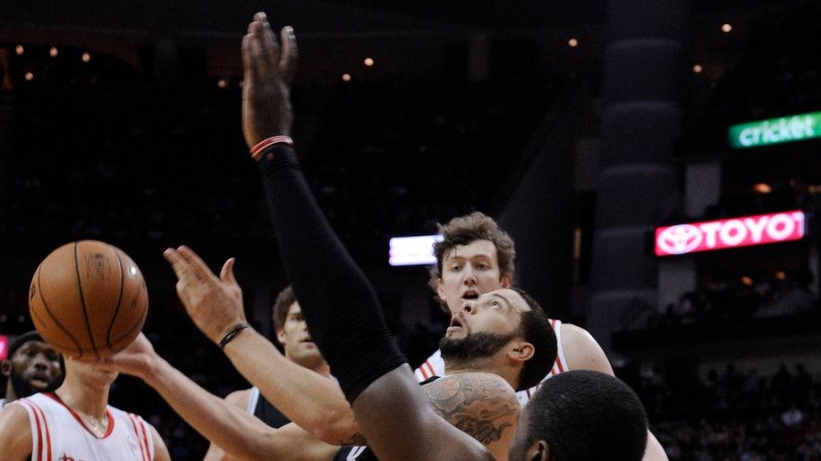 93147d8d-Nets Rockets Basketball