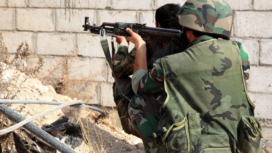 dba9b9ed-Mideast Syria