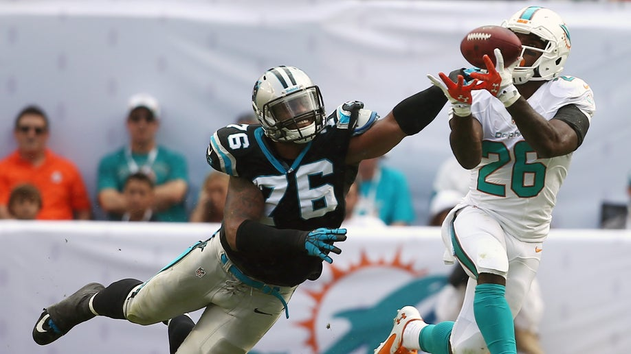1ac83f4b-APTOPIX Panthers Dolphins Football