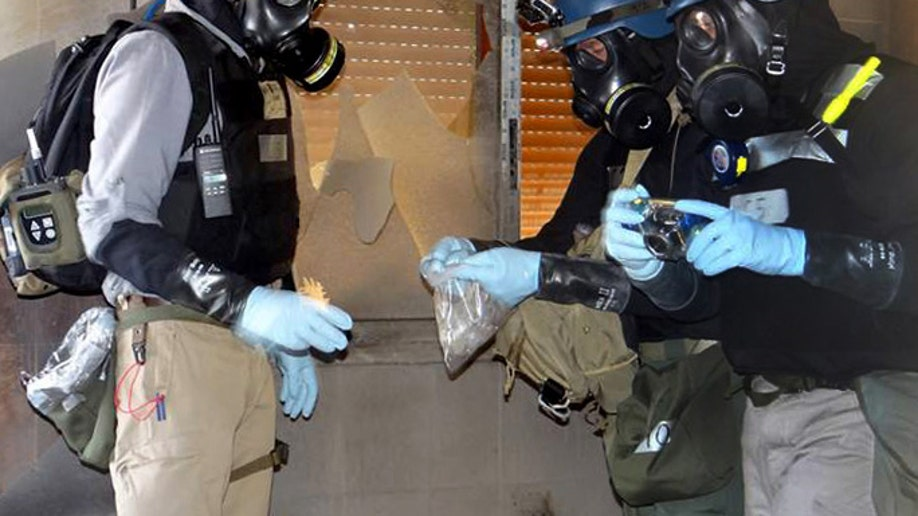 99dbc6df-Mideast Syria Chemical Weapons News Guide