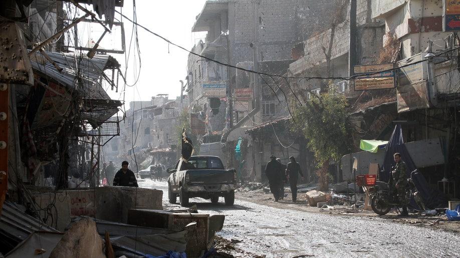 cab47480-Mideast Syria Tides of War