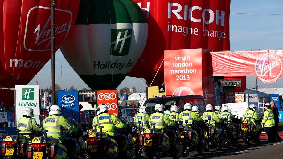 APTOPIX Britain Marathon Security