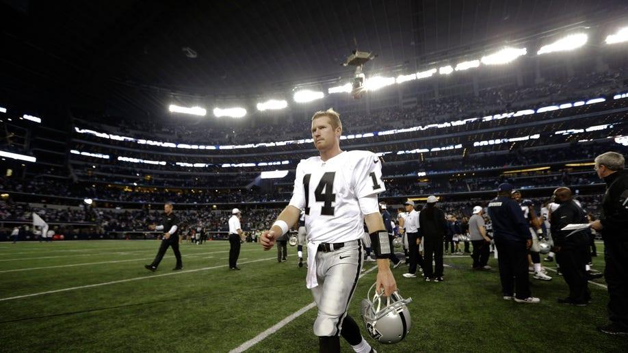 7db6eaf4-Raiders Cowboys Football