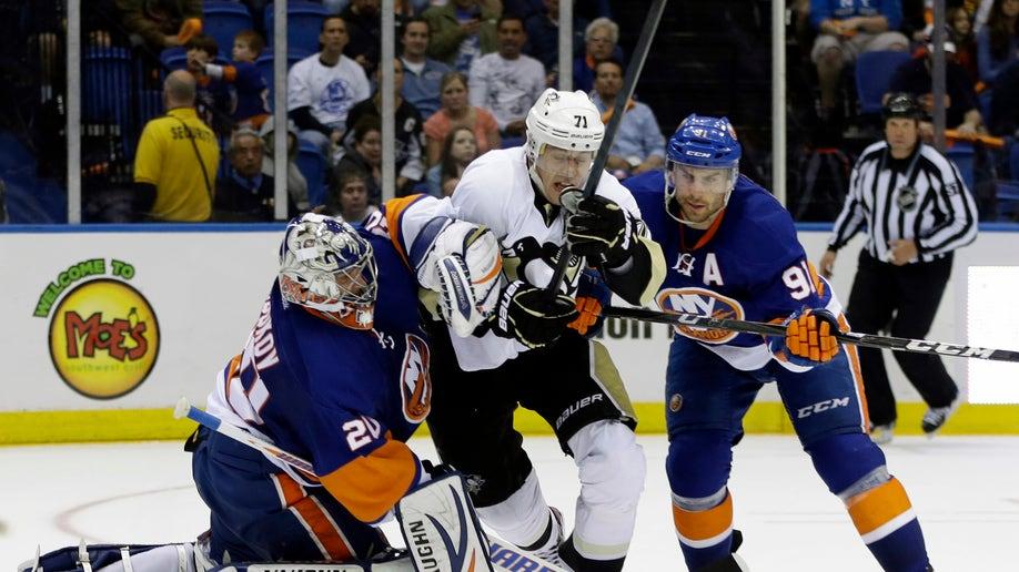 51fc9558-Penguins Islanders Hockey