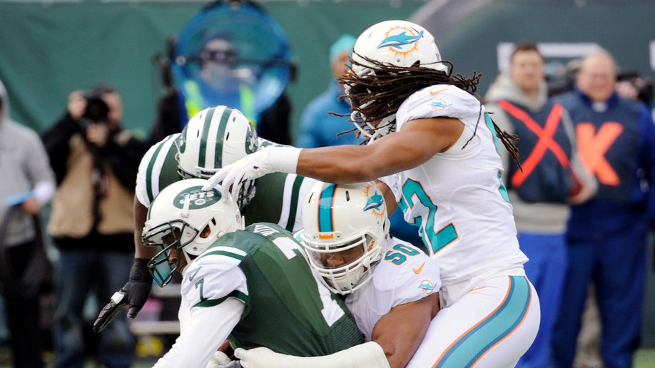 91c8b53a-Dolphins Jets Football