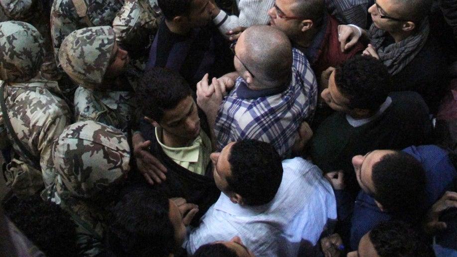 3d5c7549-Mideast Egypt State Security Return