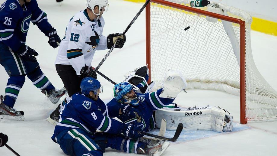 d7553cee-Sharks Canucks Hockey