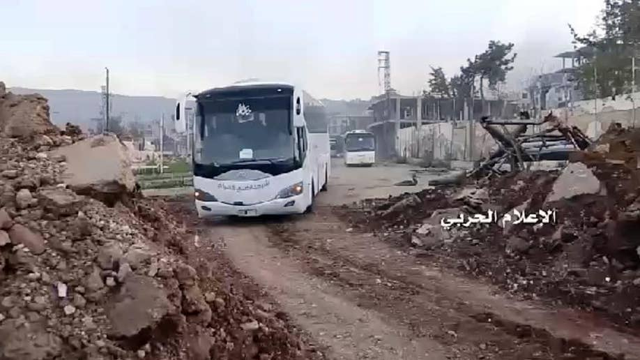 In Syria, population transfers stalled over violence resume