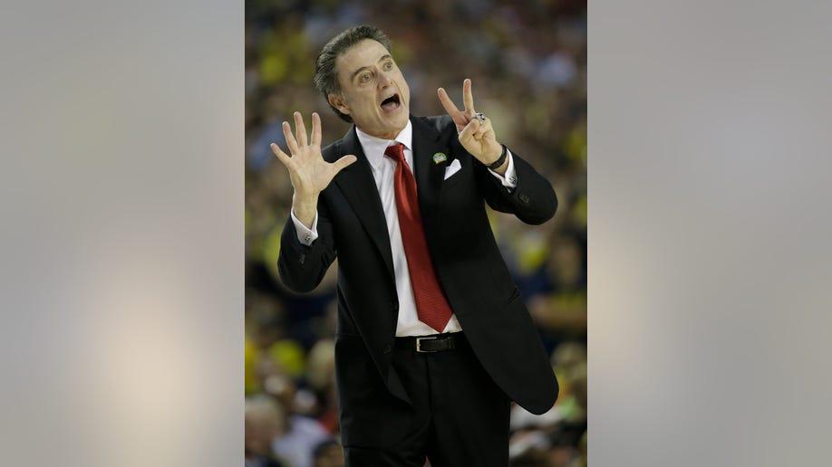 64325020-NCAA Final Four Michigan Louisville Basketball