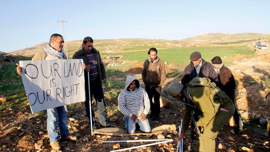 7346ebdc-Mideast Israel Palestinians