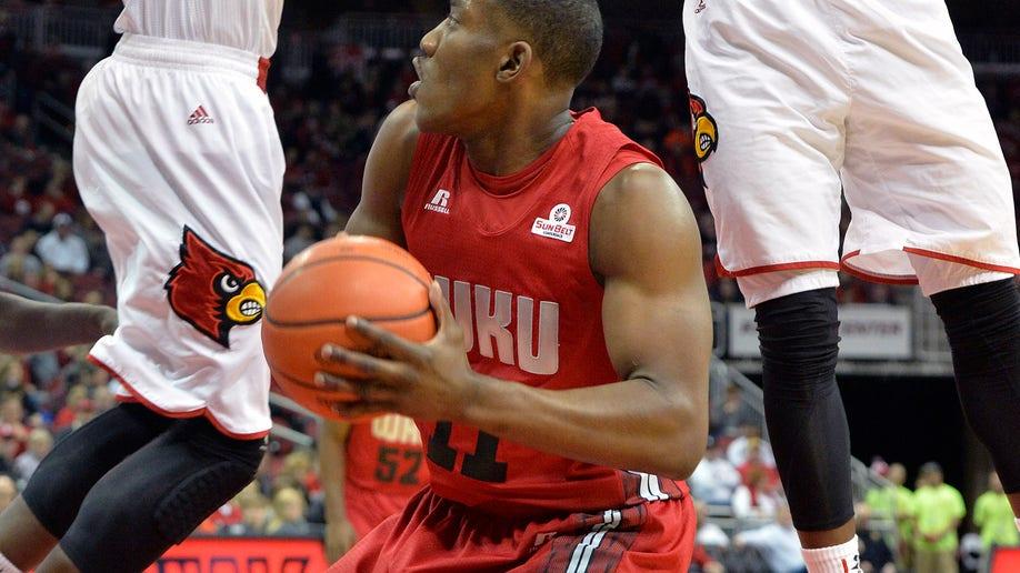 66d371dc-W Kentucky Louisville Basketball