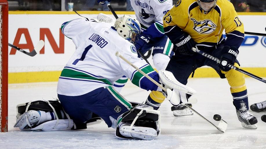 0d3926e5-Canucks Predators Hockey