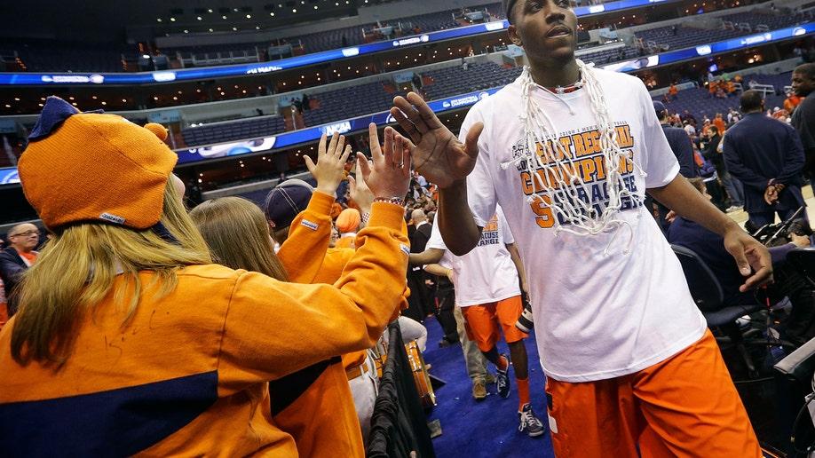 5c63079a-NCAA Syracuse Marquette Basketball