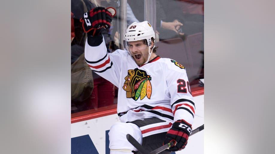 524d547a-Blackhawks Canucks Hockey