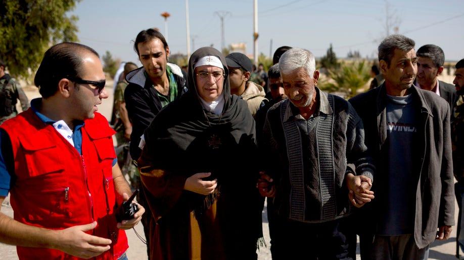 94ca3ac8-Mideast Syria Controversial Nun