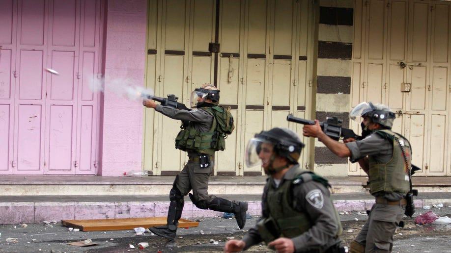 548a7138-Mideast Israel Palestinians
