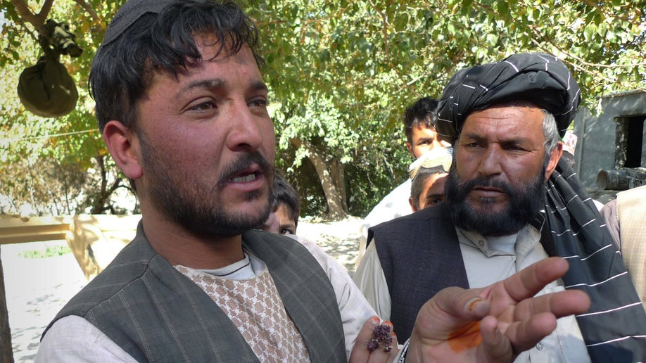 477b8a1e-Afghanistan Bringing Home The Dam