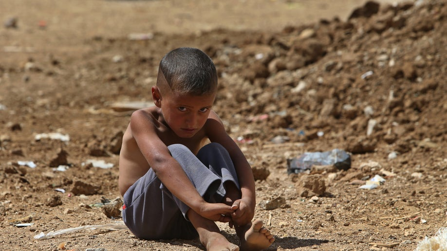 518695c7-Lebanon Syrians Go Home