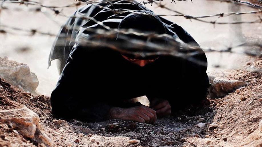 25745d13-Mideast Syria Activists on The Run