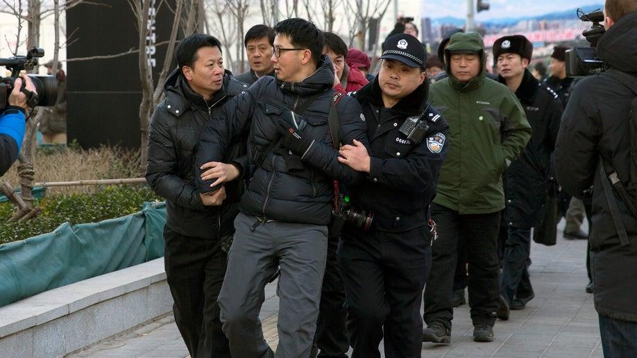 374613eb-China Journalists Under Pressure